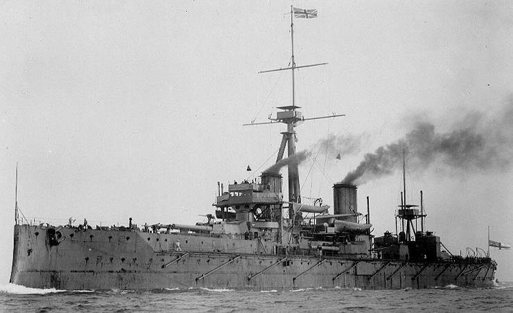 HMS Dreadnought - with ten twelve-inch Naval Guns and anti-torpedo net booms (in 1906).
