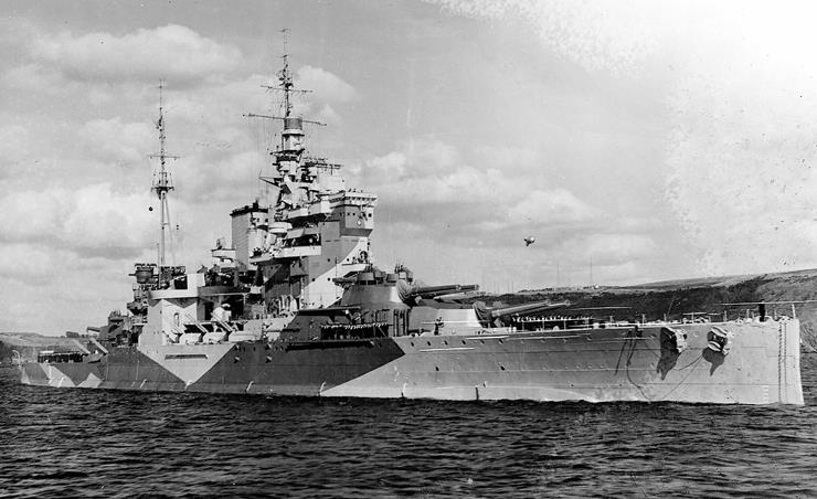 HMS Queen Elizabeth - with eight fifteen-inch Naval Guns and twenty Dual Purpose four-and-a-half-inch Quick Firing guns.